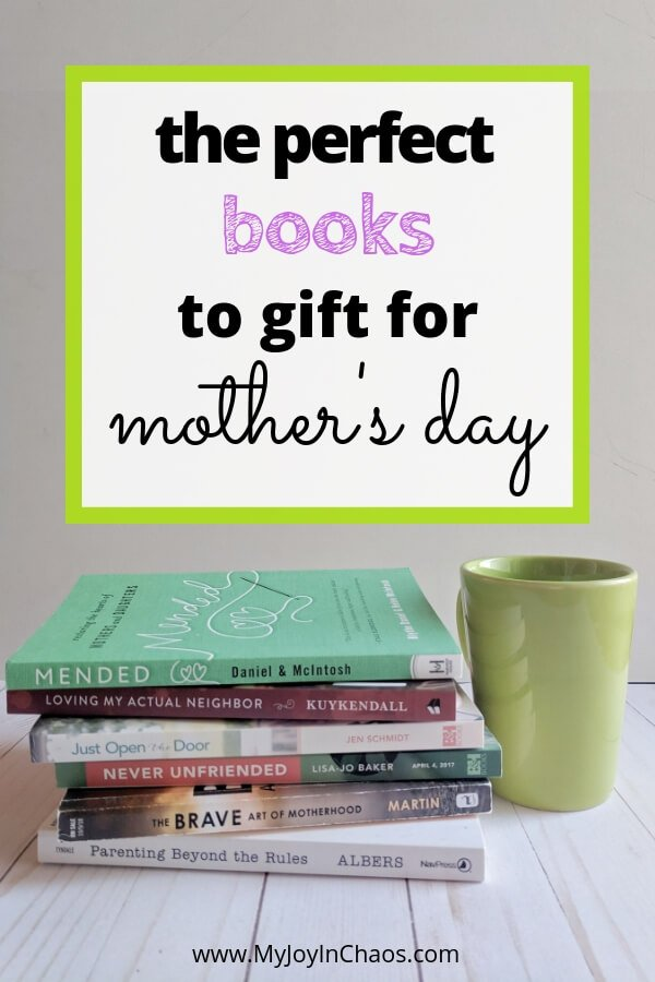 stack of books for moms with coffee cup