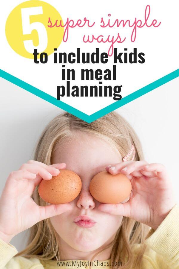 child with eggs over eyes
