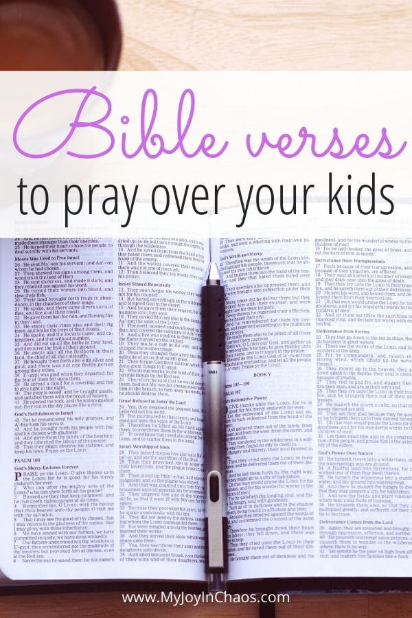 open Bible with pen and words Bible verses to pray over your kids